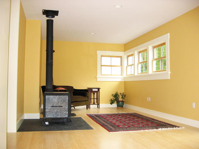 Smith & McClain, Middlebury townhouse living room with pellet stove, VT